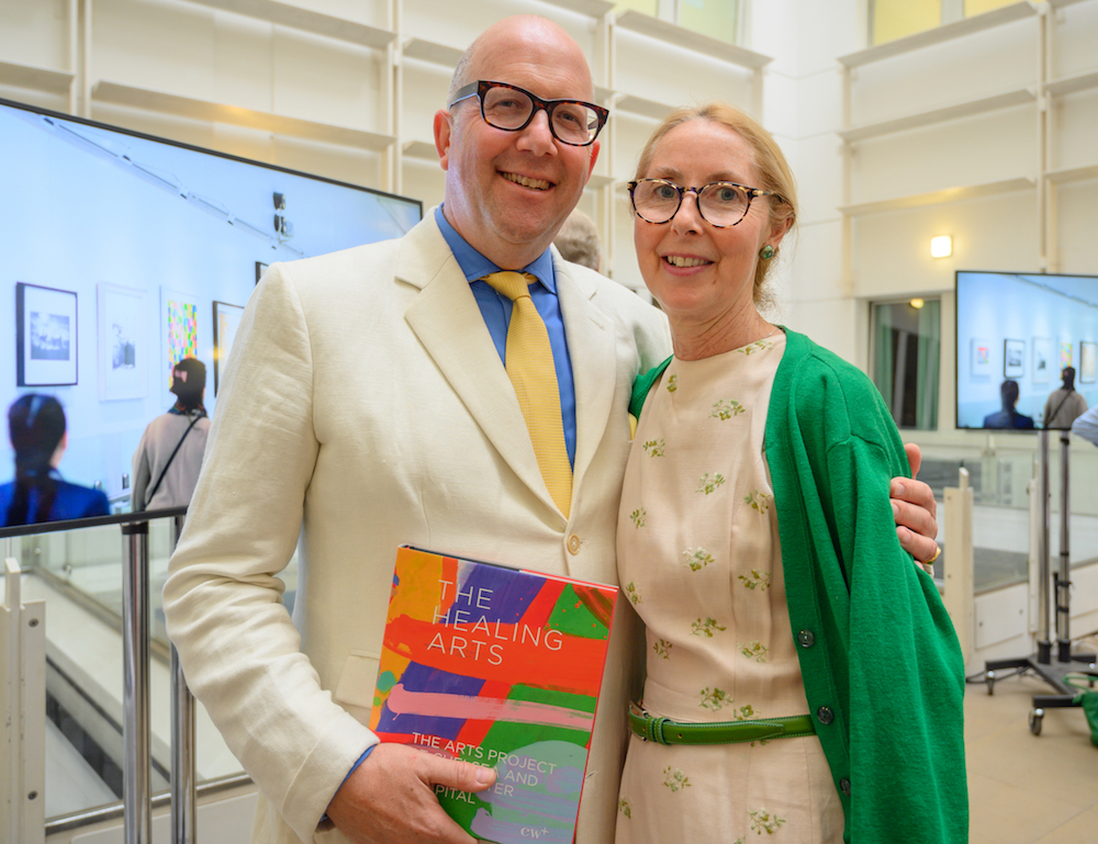 man and woman holding arts book at launch