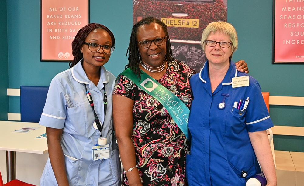 3 female staff members smiling