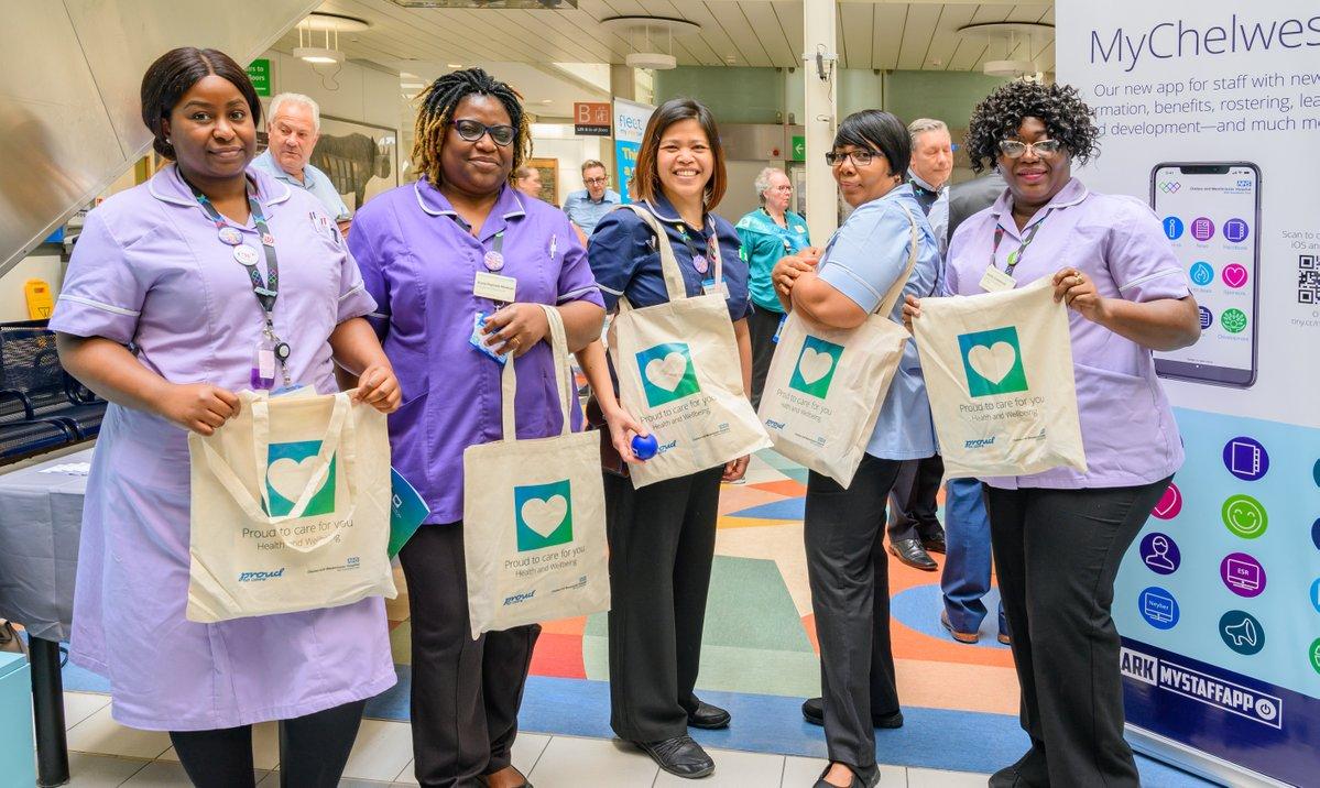 nurses holding tote bags