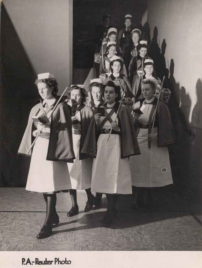 black and white photo of carol singers