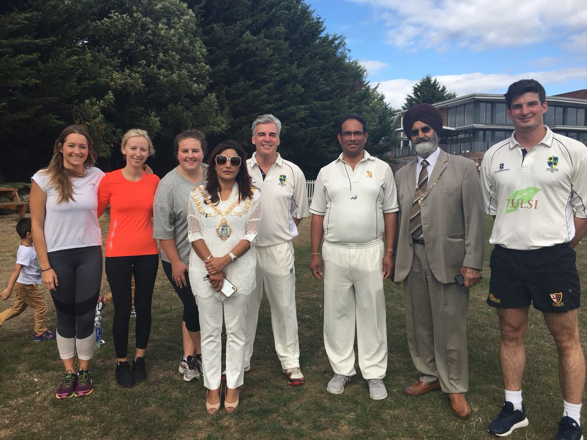 charity cricket team smiling