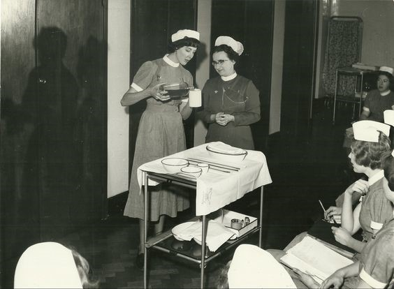 sister and nurse talking 1965