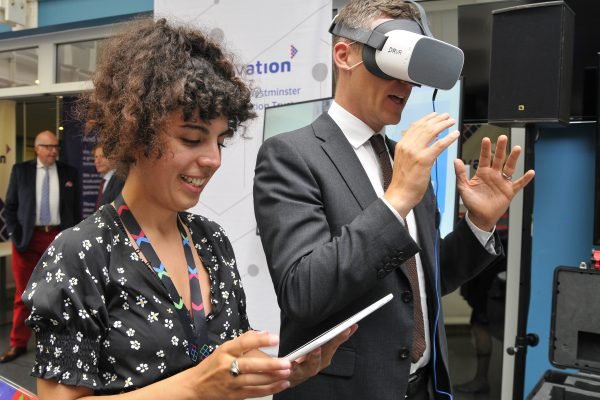 Two people demonstrating a virtual reality headset