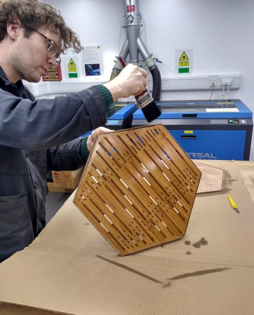Robbie from the QMUL Augmented Instrument Lab preparing the prototype